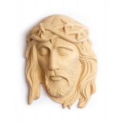 Dřevěný reliéf Krista k zavěšení na zeď.